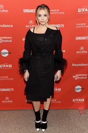 Chloe Grace Moretz styled her coat with a pair of pointy cap-toe Mary Janes, also by Prada.