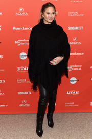 Chrissy Teigen showed off her edgy-chic winter style with this black Dorothee Schumacher cape teamed with leather leggings at the Sundance Film Festival premiere of 'Monster.'