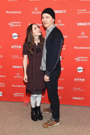 Zoe Kazan showed off her quirky style with this purple print dress, striped socks, and black boots combo at the Sundance premiere of 'Wildlife.'