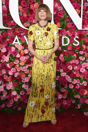 Anna Wintour looked fun and glam in a yellow sequined gown by Prada at the 2018 Tony Awards.