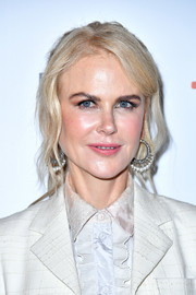 Nicole Kidman styled her hair into a ponytail with wavy tendrils for the TIFF premiere of 'Destroyer.'