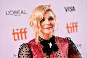 Chloe Grace Moretz glammed up with this vintage-inspired updo for the TIFF premiere of 'Greta.'