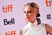 Maika Monroe styled her hair into a ponytail, complete with a black bow, for the TIFF premiere of 'Greta.'