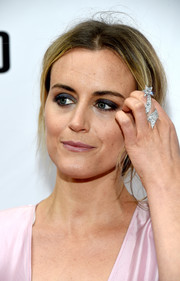 Taylor Schilling went heavy on the eyeshadow for an edgy beauty look at the TIFF premiere of 'The Public.'