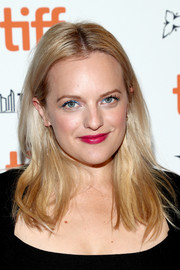 Elisabeth Moss opted for a casual center-parted hairstyle when she attended the TIFF premiere of 'Her Smell.'