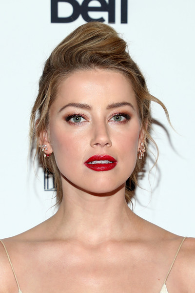 Amber Heard styled her hair into a slightly messy pompadour for the TIFF premiere of 'Her Smell.'