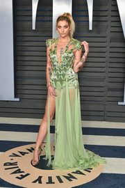 Paris Jackson was hard to miss in this lime-green Atelier Versace gown that featured a rhinestone-studded net bodice and a sheer skirt at the 2018 Vanity Fair Oscar party.
