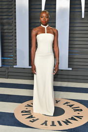 Danai Gurira was cool and modern in a white halter column dress by Gabriela Hearst at the 2018 Vanity Fair Oscar party.