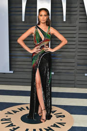 Joan Smalls looked ready to disco in a rainbow-hued cutout gown by Roberto Cavalli Couture at the 2018 Vanity Fair Oscar party.