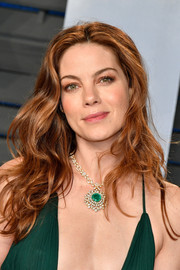 Michelle Monaghan matched her green dress with a gorgeous gemstone pendant by Beladora.