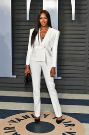 Naomi Campbell looked flawless in a strong-shouldered white suit by Alexandre Vauthier at the 2018 Vanity Fair Oscar party.
