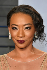 Betty Gabriel styled her tresses into a curly updo for the 2018 Vanity Fair Oscar party.