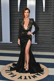 Catt Sadler captivated in a deep-V, high-slit black gown by Stello at the 2018 Vanity Fair Oscar party.