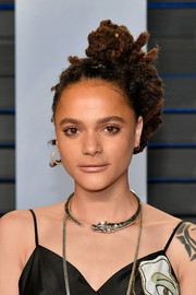 Sasha Lane rocked a punky braided updo at the 2018 Vanity Fair Oscar party.