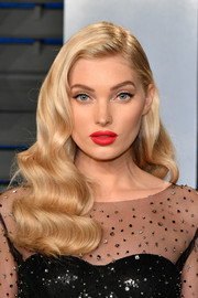 Elsa Hosk finished off her look with a bright red pout.