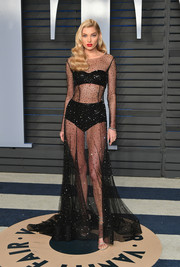 Elsa Hosk's supermodel figure was on full display in a sheer black gown by Alberta Ferretti at the 2018 Vanity Fair Oscar party.