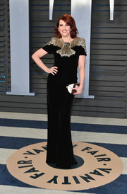 Megan Mullally rocked a black Alexander McQueen velvet column dress with a heavily beaded yoke at the 2018 Vanity Fair Oscar party.