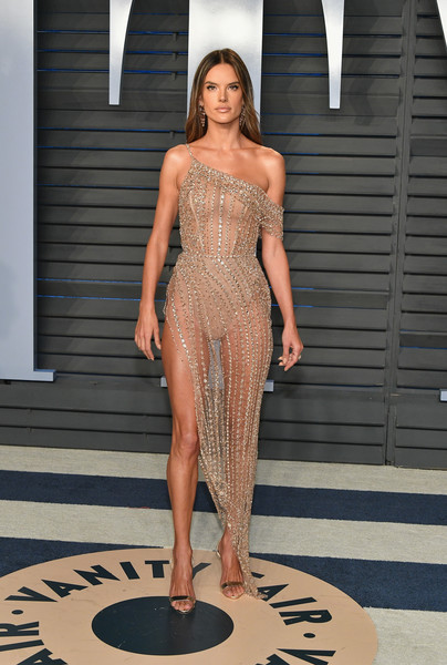 Alessandra Ambrosio teamed her barely-there dress with gold slingbacks by Giuseppe Zanotti.