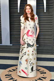 Karen Gillan looked playfully chic at the 2018 Vanity Fair Oscar party in a white Ronald van der Kemp gown adorned with multicolored beads and paint streaks.