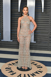 Shanina Shaik flashed an eyeful of skin in a sheer, embellished halter gown by Georges Hobeika Couture at the 2018 Vanity Fair Oscar party.