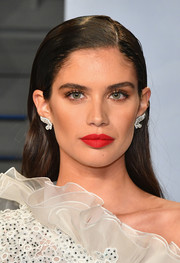 Sara Sampaio went for a fun and bold beauty look with a swipe of bright red lipstick.