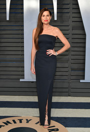 Minnie Driver went minimalist in a strapless black column dress by Zac Posen at the 2018 Vanity Fair Oscar party.