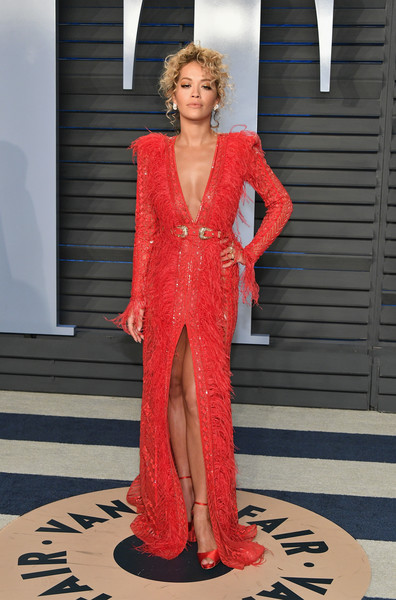 Rita Ora polished off her look with a pair of red satin peep-toes by Olgana Paris.