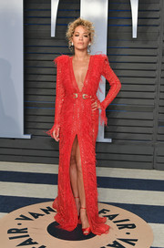 Rita Ora went for some '80s 'Dynasty' glamour in a beaded and feathered red gown by Zuhair Murad Couture at the 2018 Vanity Fair Oscar party.