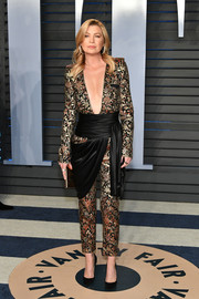 Ellen Pompeo looked fashion-forward in an Azzaro jacquard jumpsuit with a down-to-there neckline and draped fabric detailing at the 2018 Vanity Fair Oscar party.