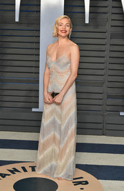 Sienna Miller charmed in a Swarovski crystal-embellished pastel slip gown by Miu Miu at the 2018 Vanity Fair Oscar party.