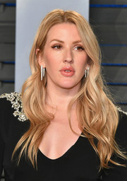 Ellie Goulding wore her hair in a cascade of waves at the 2018 Vanity Fair Oscar party.