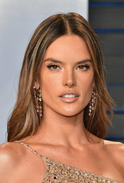 Alessandra Ambrosio attended the 2018 Vanity Fair Oscar party wearing a hippie-chic center-parted 'do.