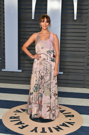 Rashida Jones kept it breezy yet chic in an embroidered lilac maxi dress by Valentino at the 2018 Vanity Fair Oscar party.