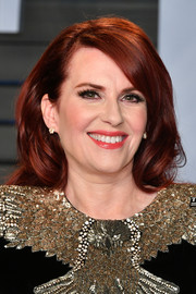Megan Mullally wore her hair down in a billowy style at the 2018 Vanity Fair Oscar party.
