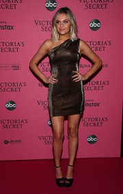 Kelsea Ballerini hit the 2018 Victoria's Secret after-party wearing a bronze one-shoulder mini dress by Haney.