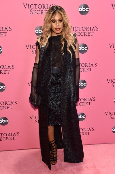 Laverne Cox layered a shimmering black Zaid Affas coat over a matching skirt and top for the 2018 Victoria's Secret fashion show.
