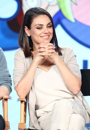 Mila Kunis opted for a neutral-tone cardigan, top, and pants ensemble when she attended the 2018 Winter TCA Tour.