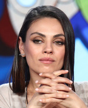 Mila Kunis sported nude nail polish to match her outfit.