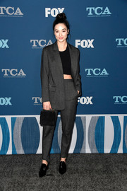 Crystal Reed pulled her outfit together with a black suede purse by M2Malletier.