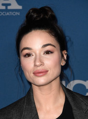 Crystal Reed worked a messy top knot at the Fox All-Star Party.