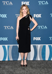 Emily VanCamp complemented her dress with black ankle-strap peep-toes.
