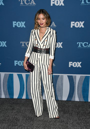 Jamie Chung gave her black-and-white look a subtle pop of color with a purple velvet clutch by Jimmy Choo.