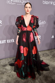 Rachel Brosnahan turned heads in a Carolina Herrera gown that featured an oversized floral print and Juliet sleeves at the 2018 amfAR Gala New York.