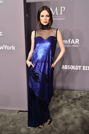 Coco Rocha looked cool and glam in an electric-blue Greta Constantine sequin gown with a sheer black yoke at the 2018 amfAR Gala New York.