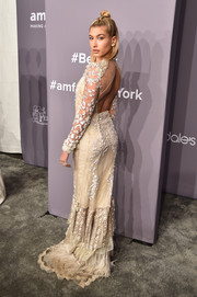 Hailey Baldwin brought some bridal glamour to the 2018 amfAR Gala New York with this Roberto Cavalli sequin-and-feather-embellished gown.