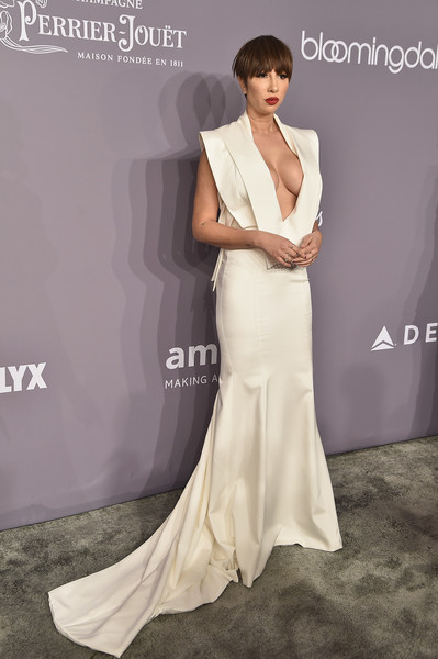 Jackie Cruz flaunted major cleavage in a plunging white fishtail gown at the 2018 amfAR Gala New York.