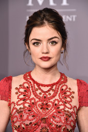 Lucy Hale swiped on some red lipstick to match her dress.