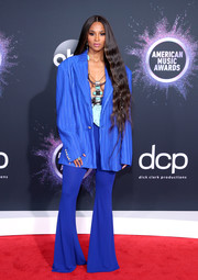 Ciara teamed her jacket with blue bell-bottoms, also by Balmain.