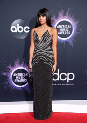 Jameela Jamil went for edgy glamour in a strapless, zebra-patterned column dress by Pamella Roland at the 2019 American Music Awards.