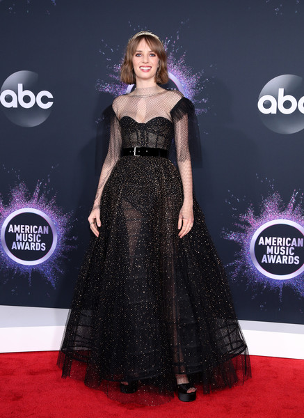 Maya Hawke stood out in a sheer black mesh gown by Dior Couture at the 2019 American Music Awards.